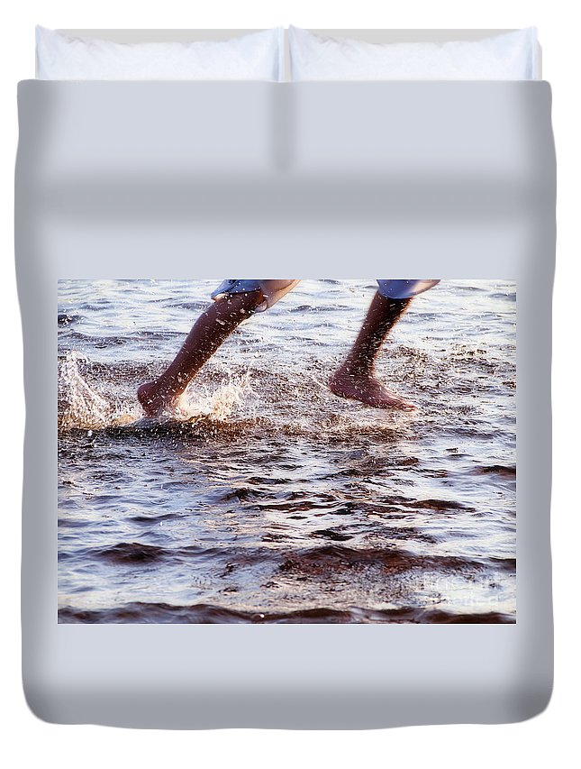 Running In The Water Duvet Cover featuring the photograph An Evening Run by Angie Rea