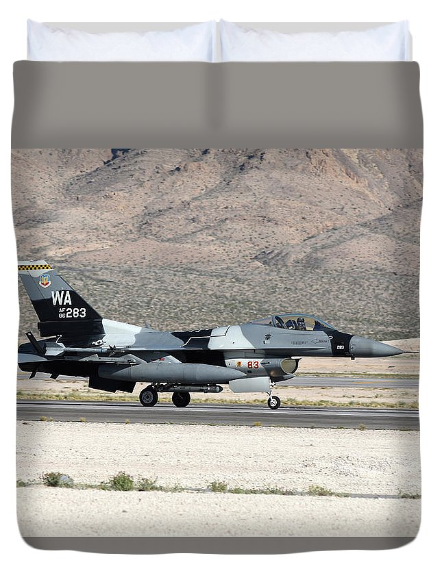 Nellis Air Force Base Duvet Cover featuring the photograph An F-16c Aggressor Jet Landing by Riccardo Niccoli
