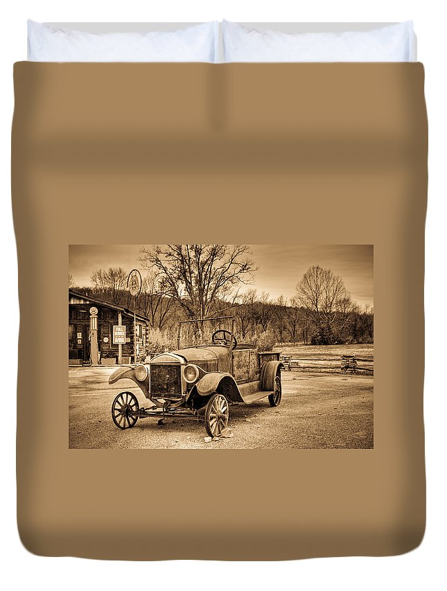 Antique Duvet Cover featuring the photograph Antique Car At Service Station In Sepia by Douglas Barnett