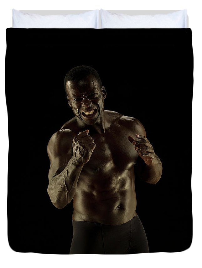 Toughness Duvet Cover featuring the photograph Athletic Female, Angry Shout, Clenched by Jonathan Knowles
