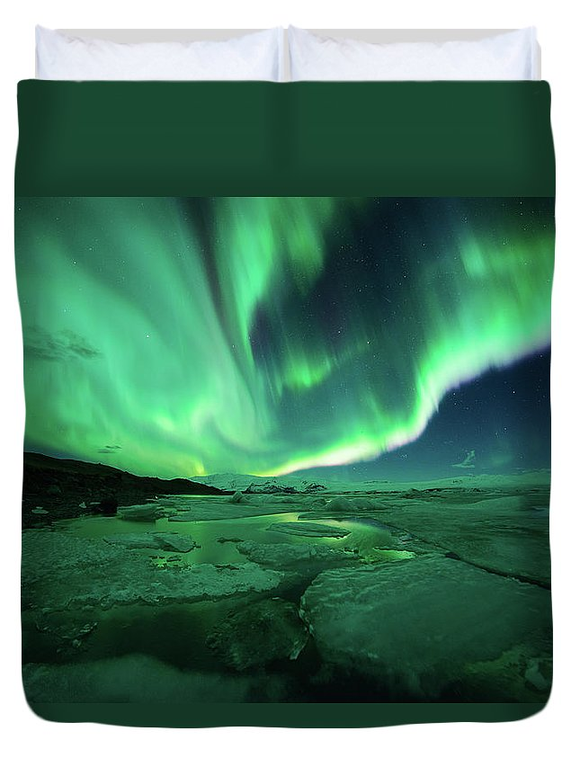 Glacier Lagoon Duvet Cover featuring the photograph Aurora Display Over The Glacier Lagoon by Natthawat