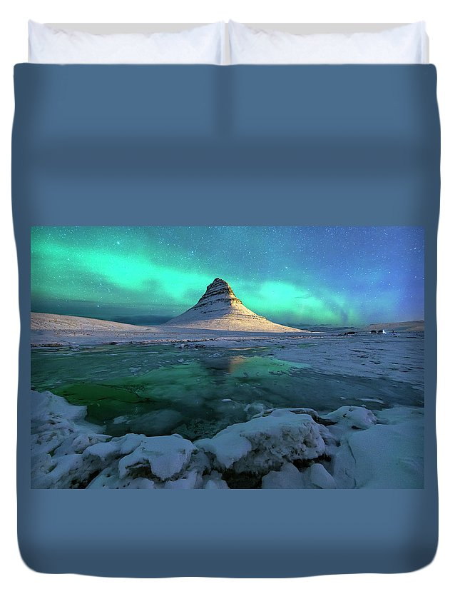 Tranquility Duvet Cover featuring the photograph Aurora Over Kirkjufell Mountain Iceland by Ratnakorn Piyasirisorost