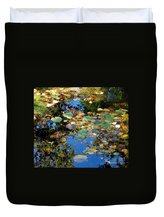 Water Duvet Cover featuring the photograph Autumn Water Lily Reflections by Nancy Mueller