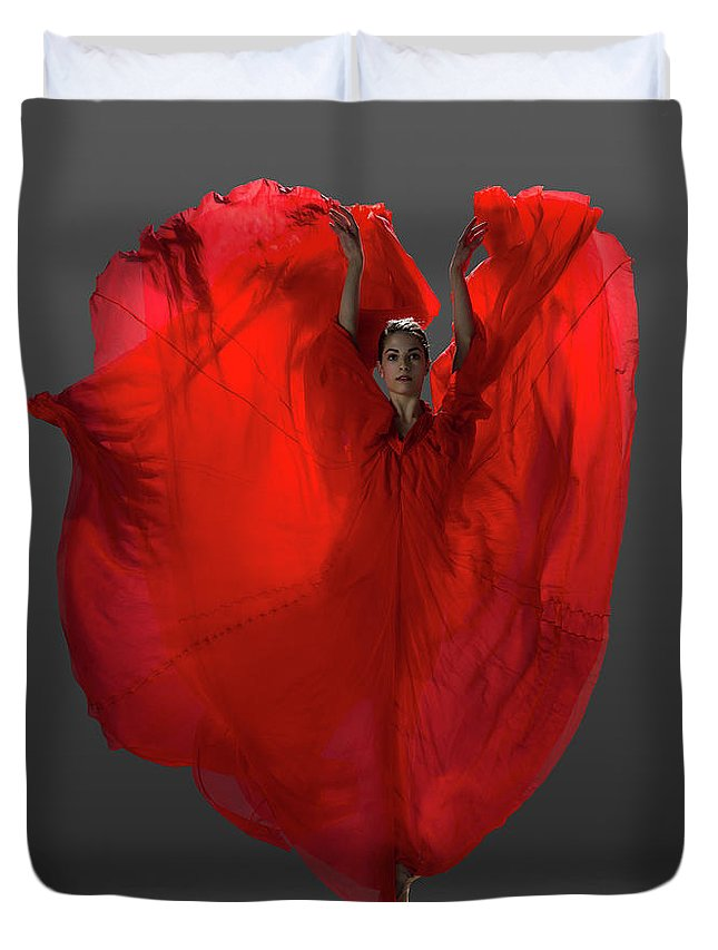 Ballet Dancer Duvet Cover featuring the photograph Ballerina On Pointe With Red Dress by Nisian Hughes