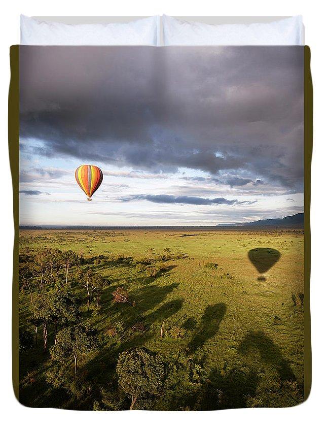 Kenya Duvet Cover featuring the photograph Balloon In Masai Mara National Park by Luis Davilla