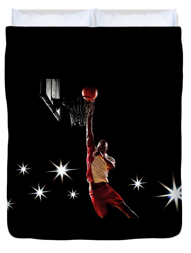 Three Quarter Length Duvet Cover featuring the photograph Basketball Player Dunking Basketball On by Compassionate Eye Foundation/chris Newton