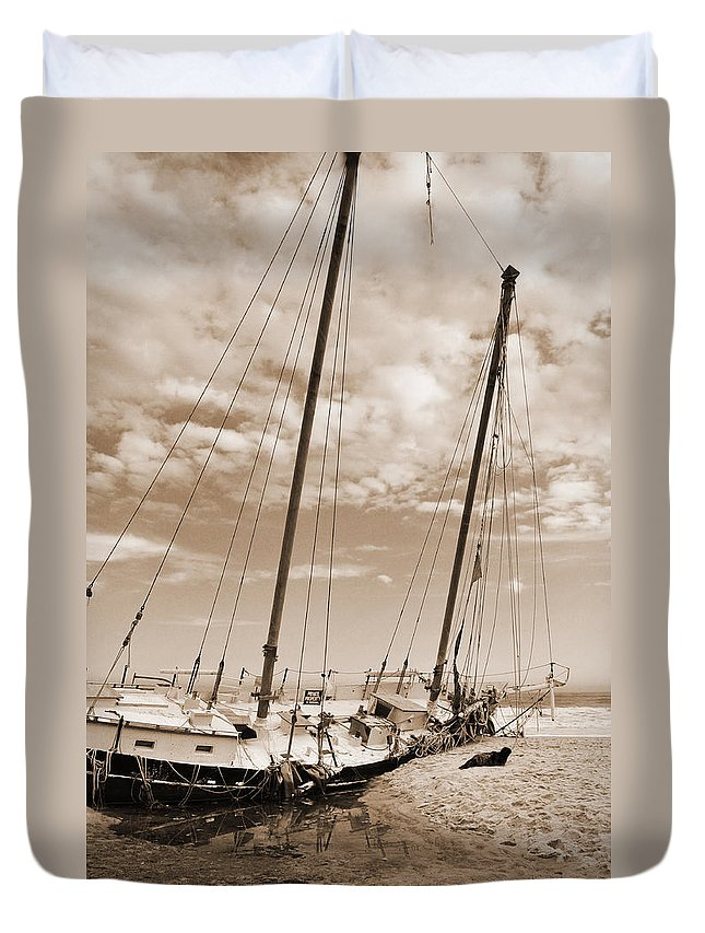 Sepia Duvet Cover featuring the photograph Beached Schooner by Nicole Jeffery