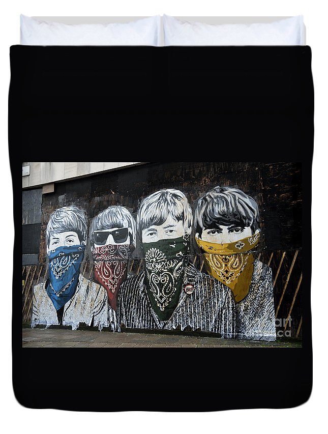 Banksy Duvet Cover featuring the photograph The Beatles wearing face masks street mural by RicardMN Photography