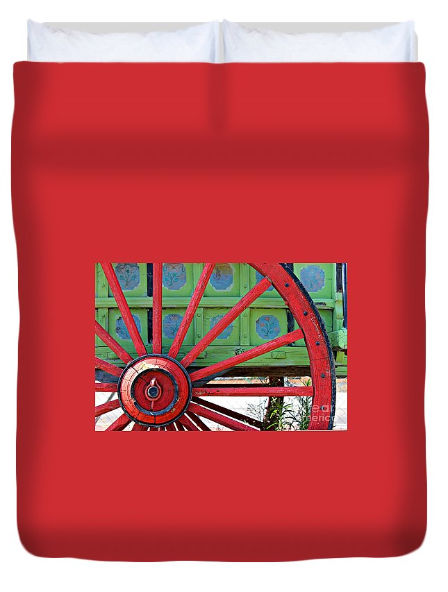 Wheel Duvet Cover featuring the photograph Big Red by Clare Bevan