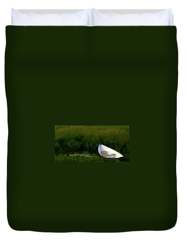 Inspirational Duvet Cover featuring the photograph Boat In The Marsh by Caroline Stella