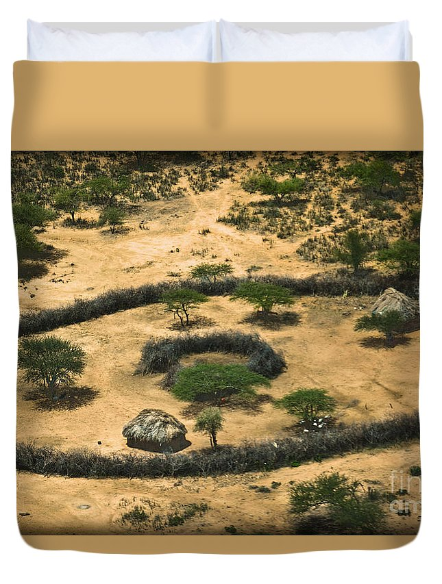 Boma Duvet Cover featuring the photograph Boma On The Range by Gary Keesler