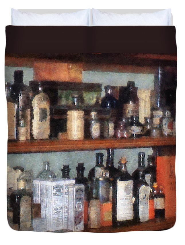General Store Duvet Cover featuring the photograph Bottles In General Store by Susan Savad