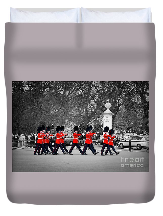 London Duvet Cover featuring the photograph British Royal Guards March And Perform The Changing Of The Guard In Buckingham Palace by Michal Bednarek
