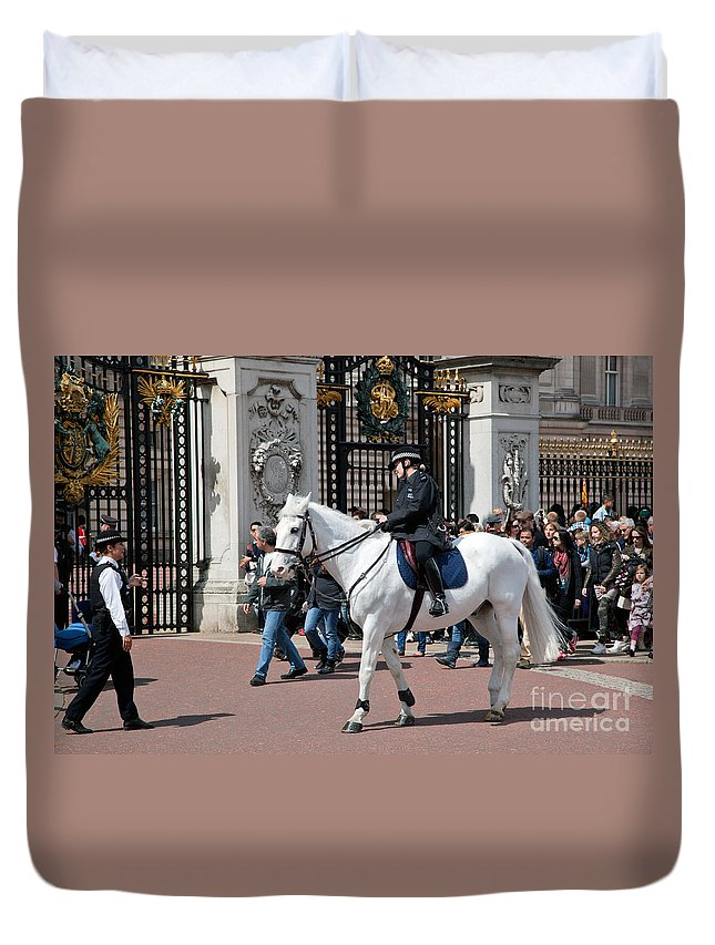 London Duvet Cover featuring the photograph British Royal Guards Perform The Changing Of The Guard In Buckingham Palace by Michal Bednarek