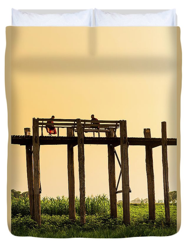 Grass Duvet Cover featuring the photograph Buddhist Monks Seated On U Bein Bridge by Merten Snijders