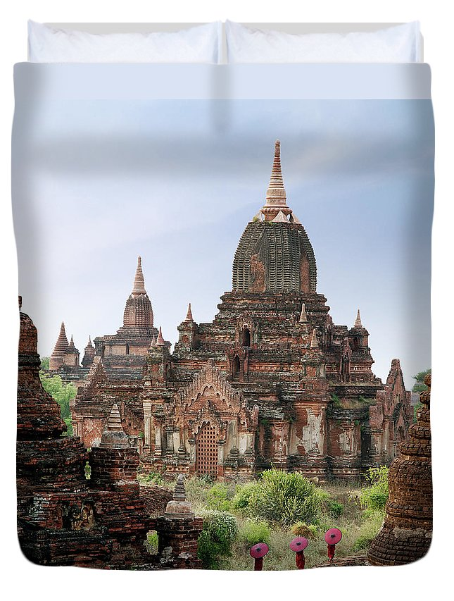 Tranquility Duvet Cover featuring the photograph Buddhist Monks Walking Past Temple by Martin Puddy