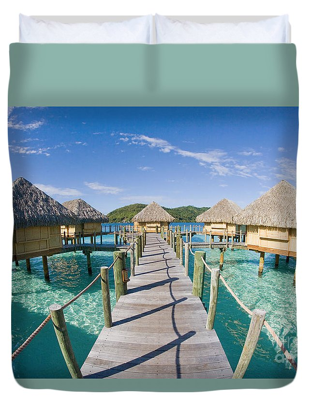 Above Duvet Cover featuring the photograph Bungalows Over Ocean by M Swiet Productions