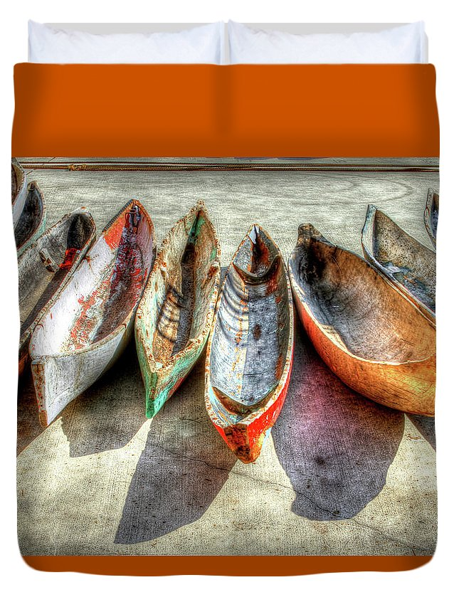 The Duvet Cover featuring the photograph Canoes by Debra and Dave Vanderlaan