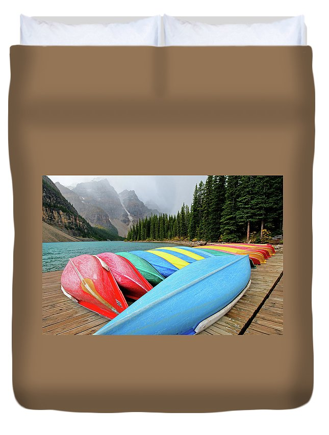 Scenics Duvet Cover featuring the photograph Canoes Line Dock At Moraine Lake, Banff by Wildroze