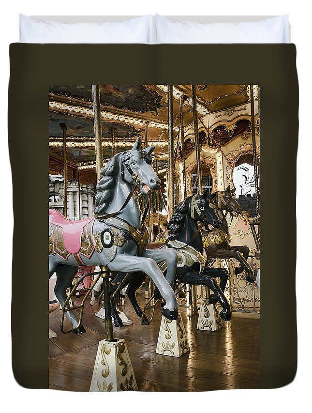 Carousel Duvet Cover featuring the photograph Carousel by Phyllis Taylor