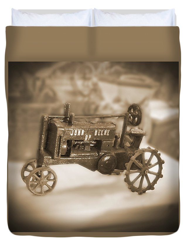 Cast Iron Toy Duvet Cover featuring the photograph Cast Iron Toys by Mike McGlothlen