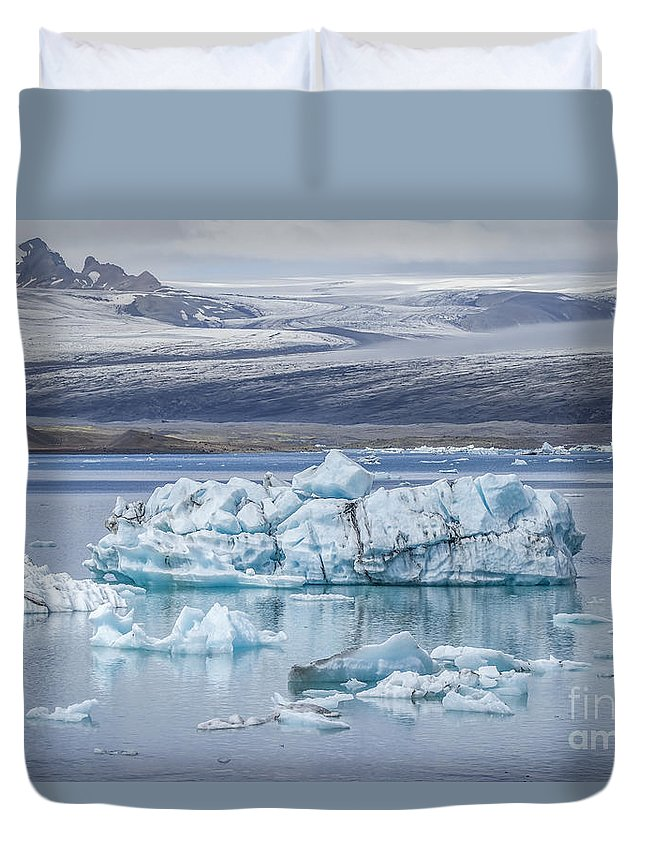 Jokulsarlon Duvet Cover featuring the photograph Chasing Ice by Evelina Kremsdorf