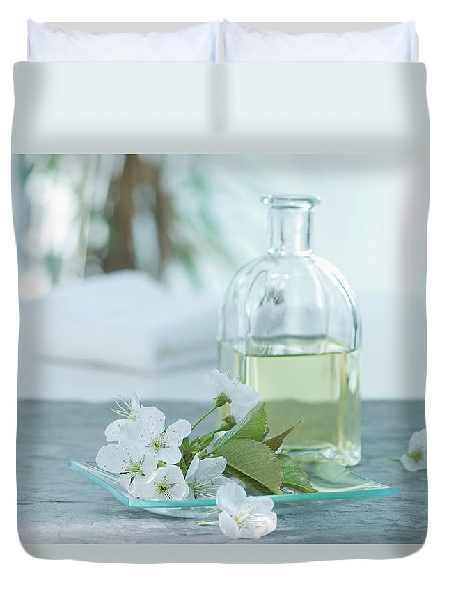 Spa Duvet Cover featuring the photograph Cherry Blossom With Aroma Oil, Close Up by Westend61