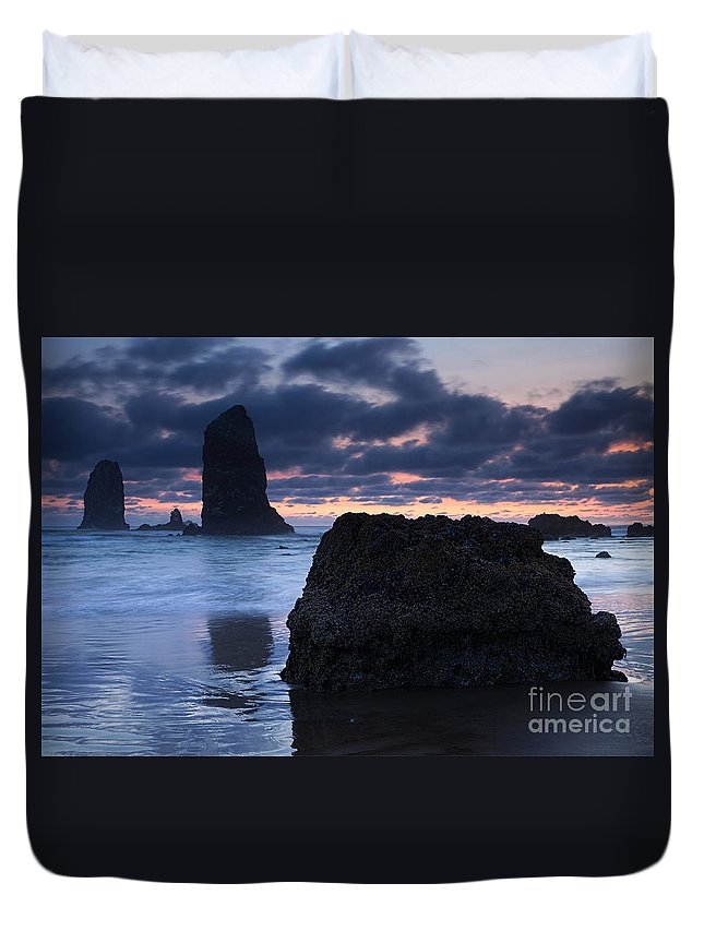 The Needles Duvet Cover featuring the photograph Chiseled By The Sea by Mike Dawson