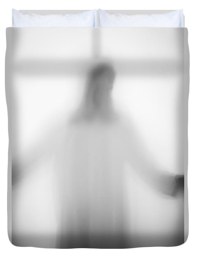 Silhouette; Jesus; Christ; Jesus Christ; Cross; Person; Faceless; Shadow; White; Prayer; Religious; Religion; Angelic; Horror; Mysterious; Christian; Faith; Icon; God; Saint; Arms Outstretched; Robe; Suspense; Prayer; Backlit; Creepy; Opaque Duvet Cover featuring the photograph Christian by Margie Hurwich