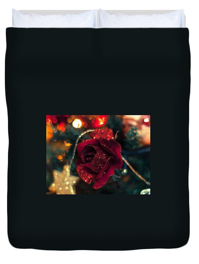 Rose Duvet Cover featuring the photograph Christmas Rose by Andrea Mazzocchetti
