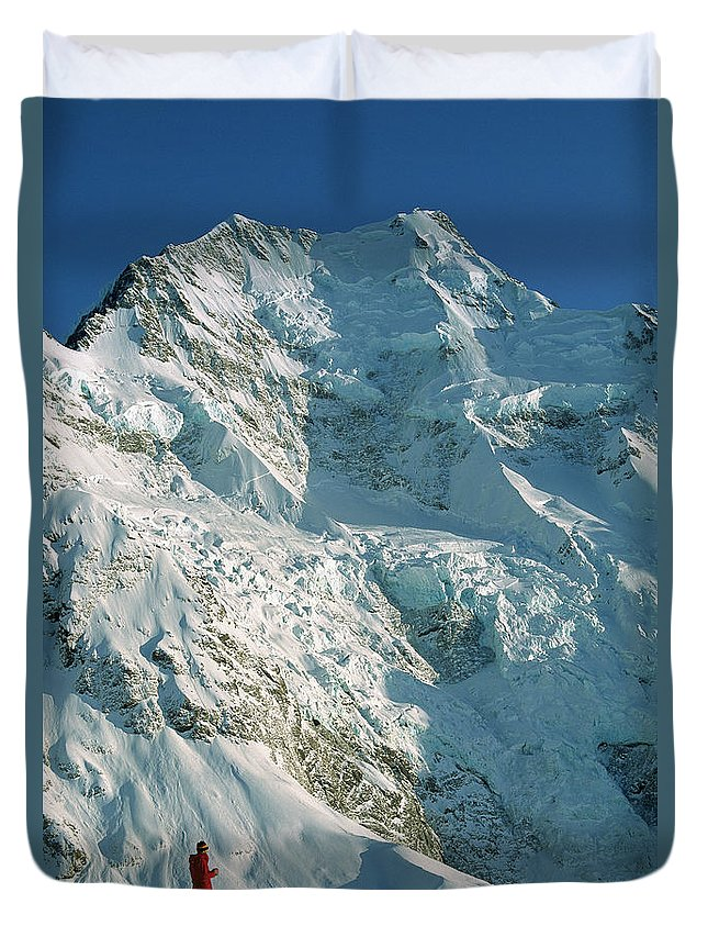 00260054 Duvet Cover featuring the photograph Climber Enjoying View Of Mt Cook by Colin Monteath