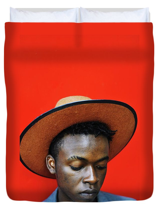 Young Men Duvet Cover featuring the photograph Close-up Of Man Wearing Hat Against Red by Samson Wamalwa / Eyeem