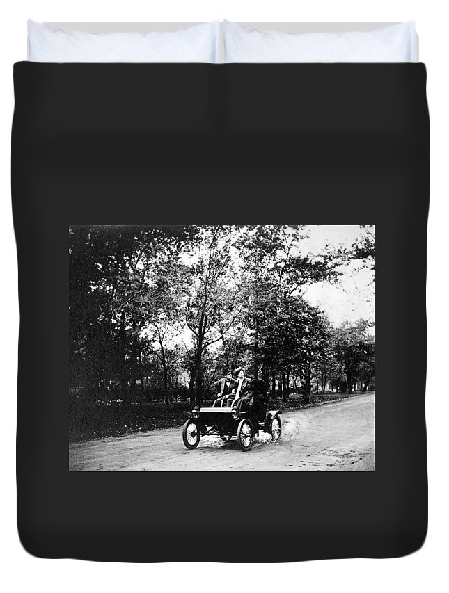 1907 Duvet Cover featuring the photograph Couple Driving, C1907 by Granger