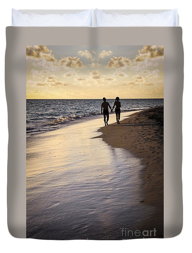 Couple Duvet Cover featuring the photograph Couple Walking On A Beach by Elena Elisseeva