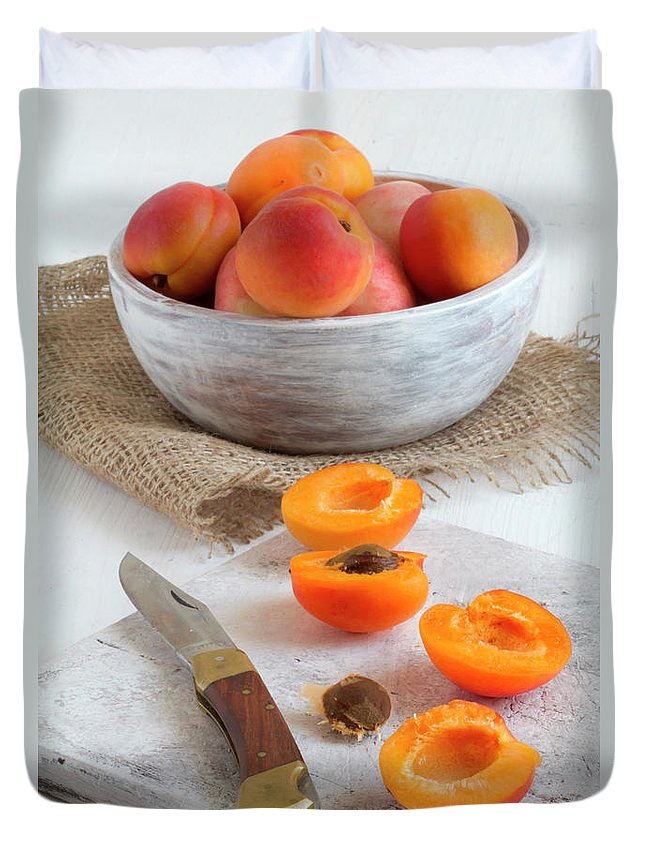 Cutting Board Duvet Cover featuring the photograph Cross Section Apricots With Knife And by Westend61