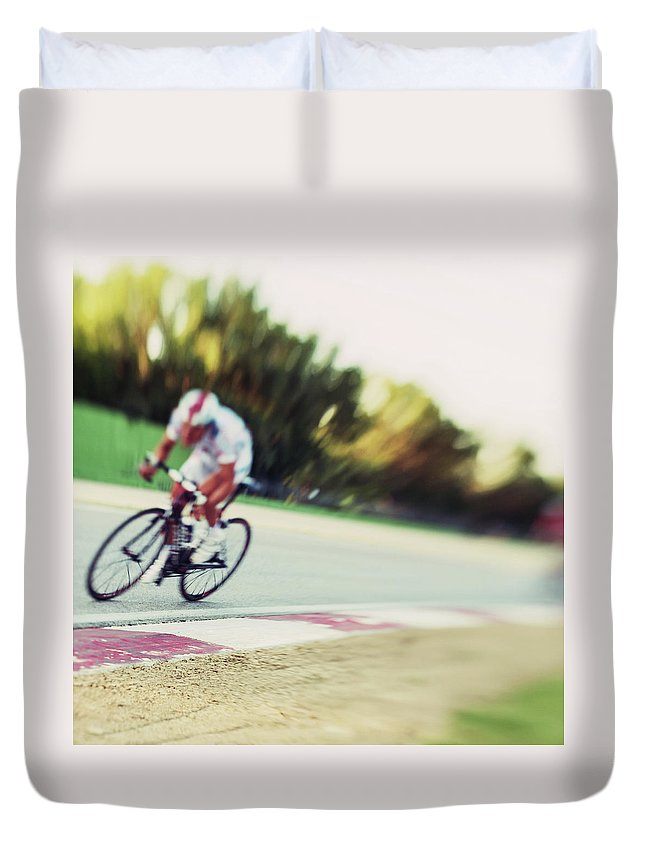 Event Duvet Cover featuring the photograph Cyclist In A Circuit by Gianlucabartoli