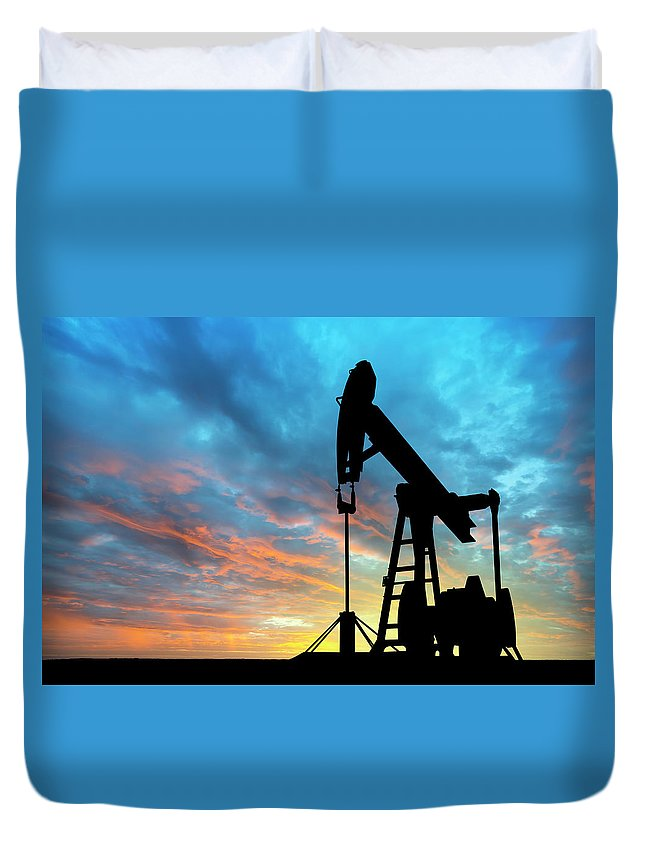 Shadow Duvet Cover featuring the photograph Dawn Over Petroleum Pump by Grafissimo