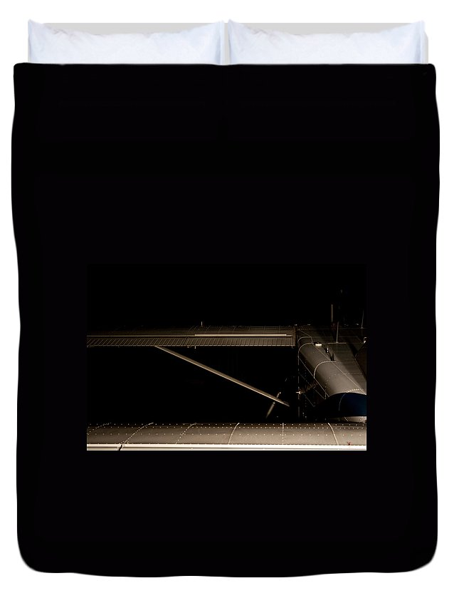 Pliatus Pc 6 Porter Duvet Cover featuring the photograph Dim Light by Paul Job
