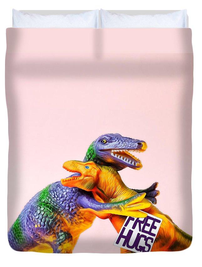 Fun Duvet Cover featuring the photograph Dinosaurs Hugging by Juj Winn