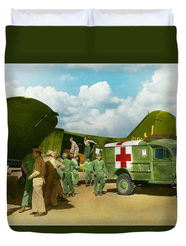 C-47 Duvet Cover featuring the photograph Doctor - Transferring The Wounded by Mike Savad