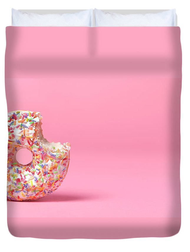 Unhealthy Eating Duvet Cover featuring the photograph Doughnut On Pink With Bite Out by Peter Dazeley