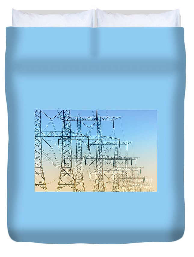 Electricity Duvet Cover featuring the photograph Electricity Pylons Standing In A Row by Nick Biemans