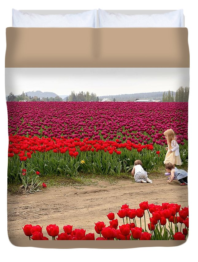 Tulips Duvet Cover featuring the photograph Exploring The Tulip Fields by Jennifer Wheatley Wolf