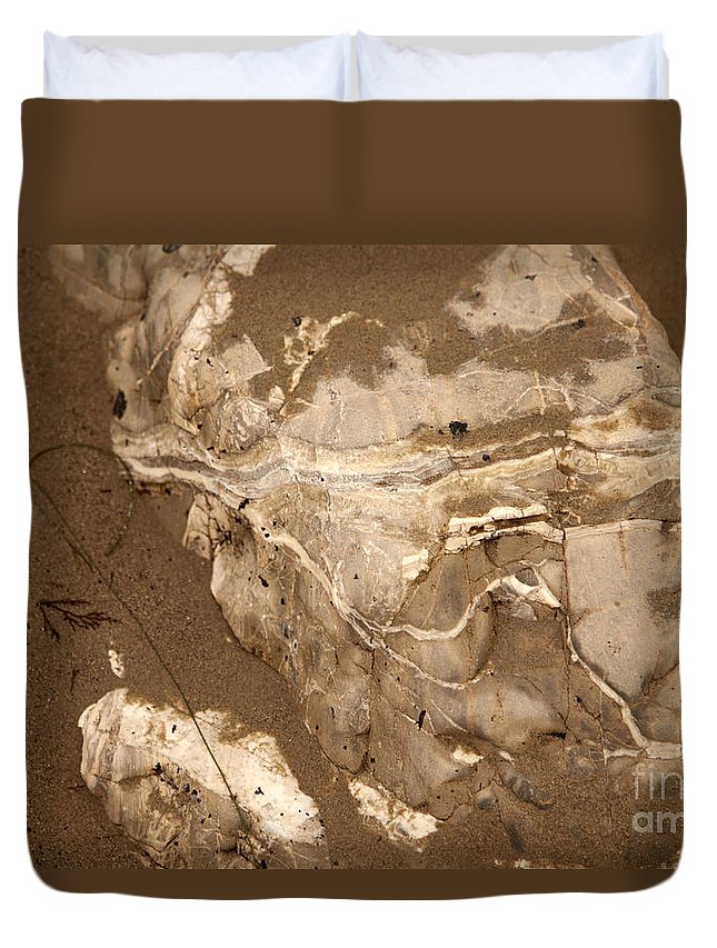 close Up Of Rocks In Sand Duvet Cover featuring the photograph Facing The Past by Amanda Barcon