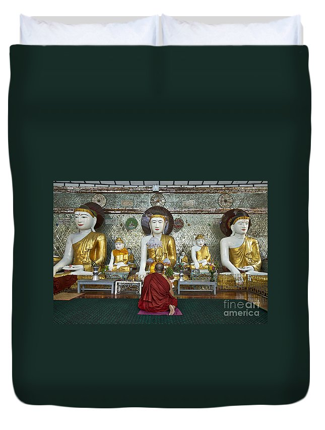 Myanmar Duvet Cover featuring the photograph faithful Buddhist monk praying at Buddha Statues in SHWEDAGON PAGODA by Juergen Ritterbach