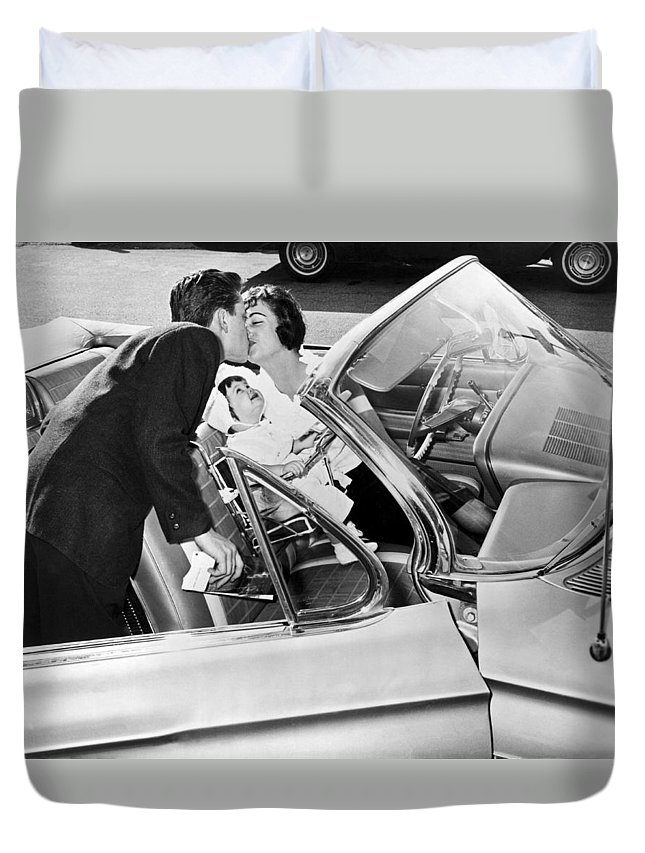 1956 Duvet Cover featuring the photograph Family Kiss by Underwood Archives