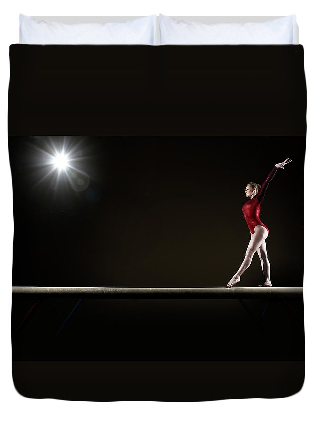 Human Arm Duvet Cover featuring the photograph Female Gymnast Balancing On Beam by Mike Harrington
