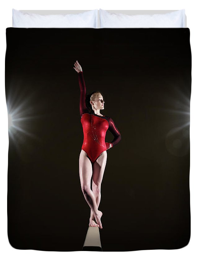 Human Arm Duvet Cover featuring the photograph Female Gymnast On Balancing Beam by Mike Harrington