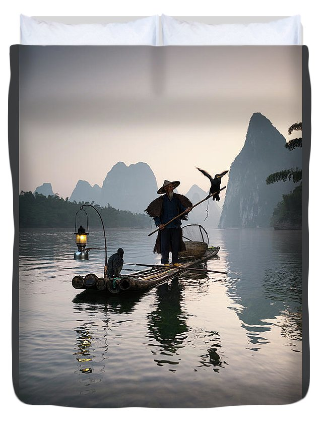Chinese Culture Duvet Cover featuring the photograph Fisherman With Cormorants On Li River by Matteo Colombo