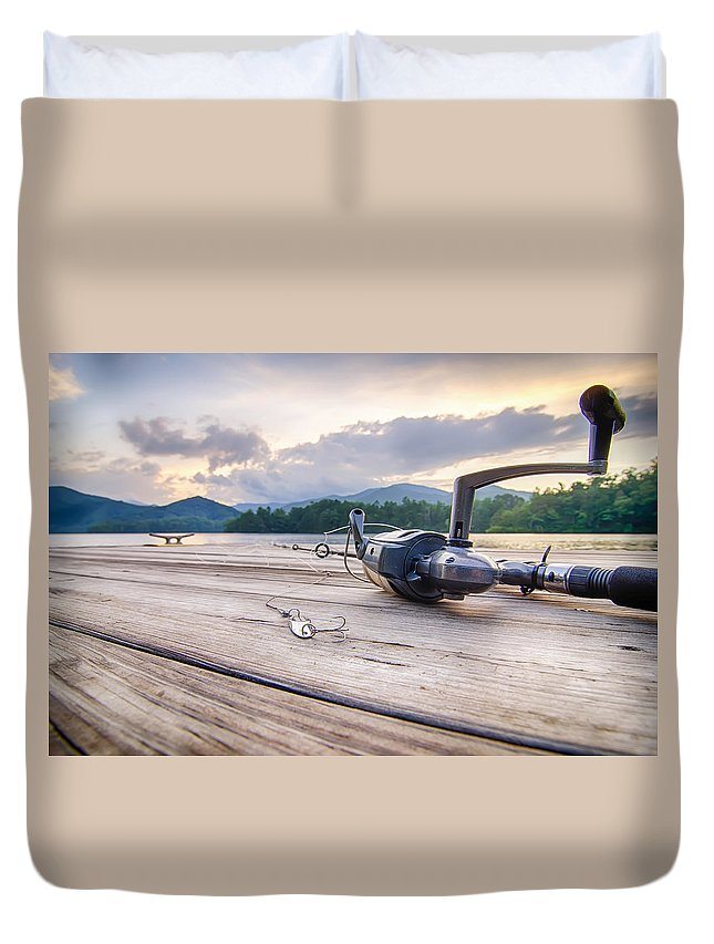 Accessories Duvet Cover featuring the photograph Fishing Tackle On A Wooden Float With Mountain Background In Nc by Alex Grichenko
